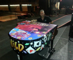 Use Your Illusion: Team Acme Wraps Axl Rose's Piano